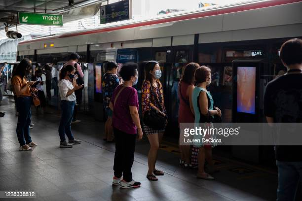 Thai people wearing masks line up for the BTS Skytrain on September 4, 2020 in Bangkok, Thailand. On September 3, 2020 Thailand confirmed its first...