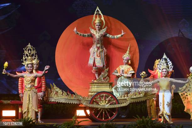 Thai performers dance wearing traditional costume during the 2018 Miss Universe national costume presentation in Chonburi province on December 10 2018