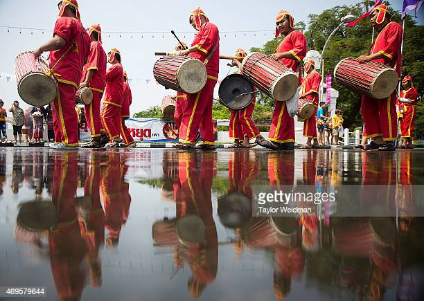 Thai performers take part in a Songkran parade on April 13 2015 in Chiang Mai Thailand The Songkran festival marking the traditional Thai New Year is...