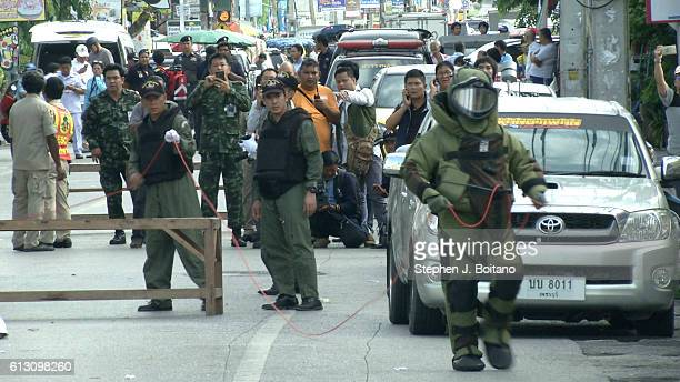Thai police bomb squad prepare to detonate a bomb near the clock tower at the site of the second explosions in Hua Hin Thailand 12 hours after the...