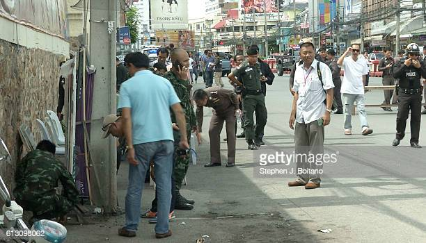 Thai police crime scene investigators search near the clock tower at the site of the second explosions in Hua Hin Thailand 12 hours after the first A...