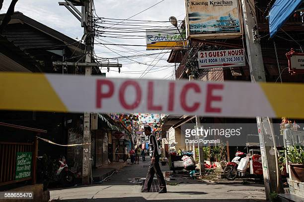 Thai police officer stands at the site of an explosion on Friday August 12 2016 in Hua Hin Thailand A series of coordinated blasts across Southern...