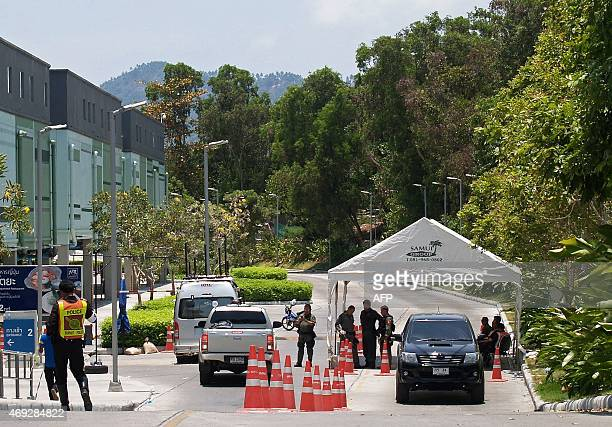 Thai police officers man a checkpoint outside a shopping mall a day after a bomb packed inside a pickup truck with false number plates exploded in...