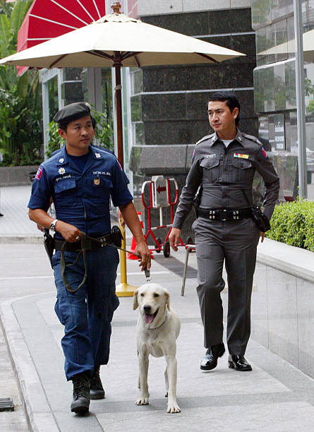 Thai Police Officers Patrol Along With A