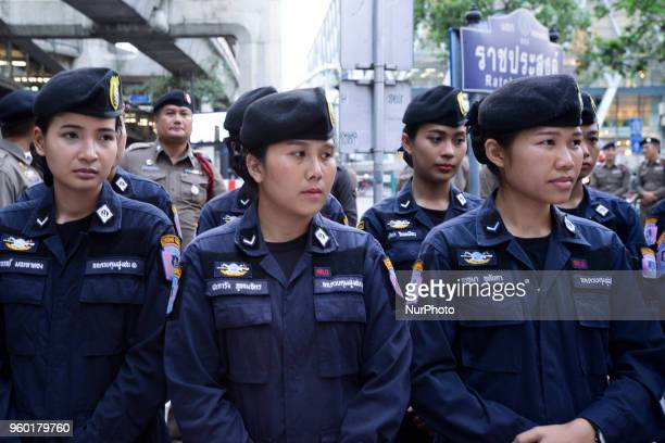 Thai police officers stand guard ahead of a gathering by activists at the Ratchaprasong intersection in Bangkok, Thailand, 19 May 2018.