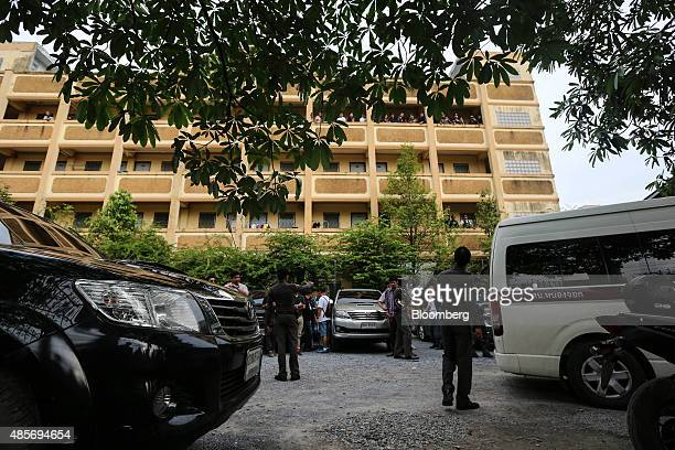 Thai police officers stand outside a building where the suspect of the August 17 Bangkok shrine bombing was detained, in Nong Chok, North West of...