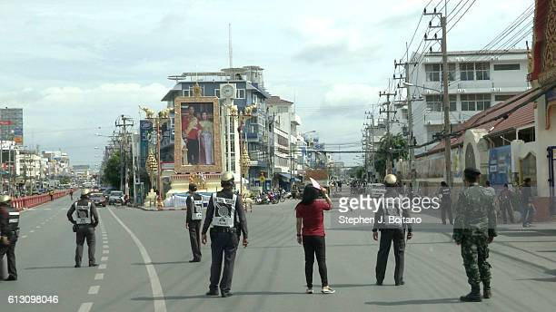 Thai police officers stands near the clock tower at the site of the second explosions in Hua Hin Thailand 12 hours after the first A series of...