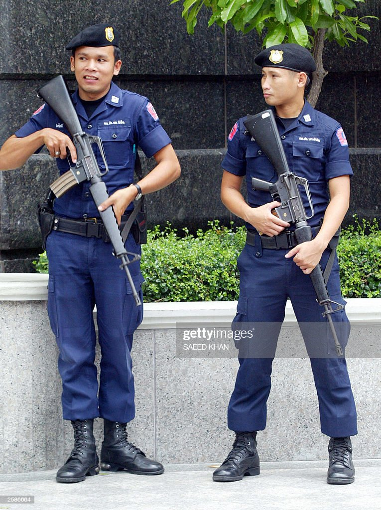 Thai Police Officers Take Their Position Outside One Of The Us Managed Hotel Near
