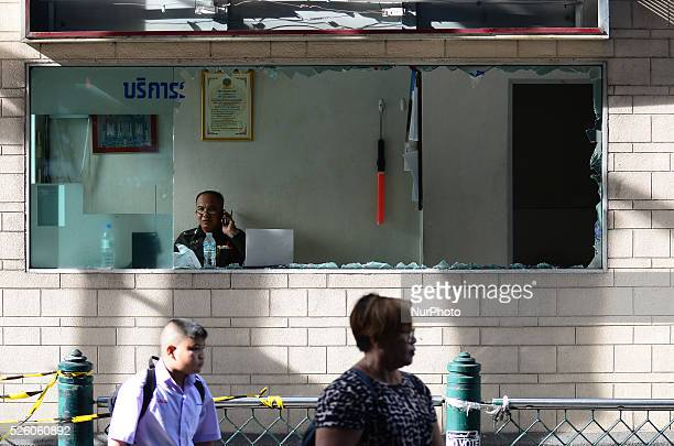 Thai policeman sits in a police booth with damaged by the bomb blast near the Erawan Shrine in Bangkok, Thailand on August 18, 2015. In the evening...