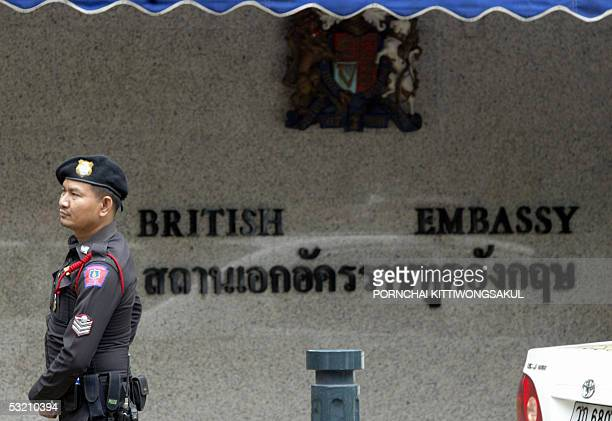 Thai policeman stands guard at the entrance of British embassy in Bangkok 08 July 2005 after bomb attacks in London's mass transit subway and bus...