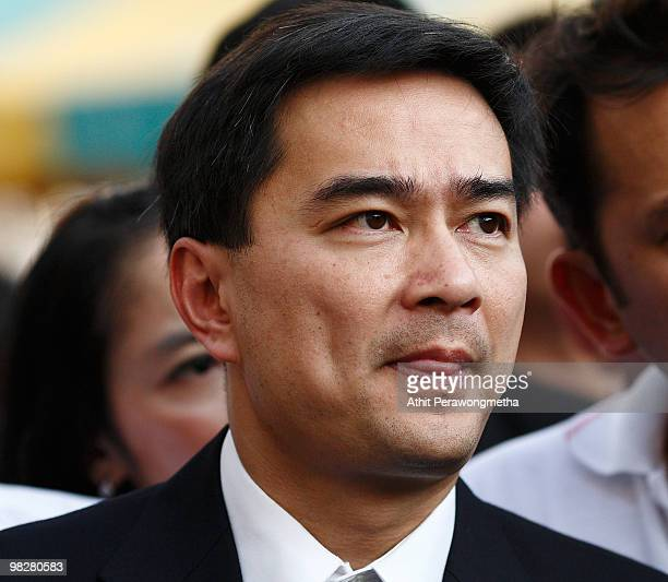Thai Prime Minister Abhisit Vejjajiva bites his lip after inspecting the damage of a police truck caused by grenade explosion at Democrat Party...