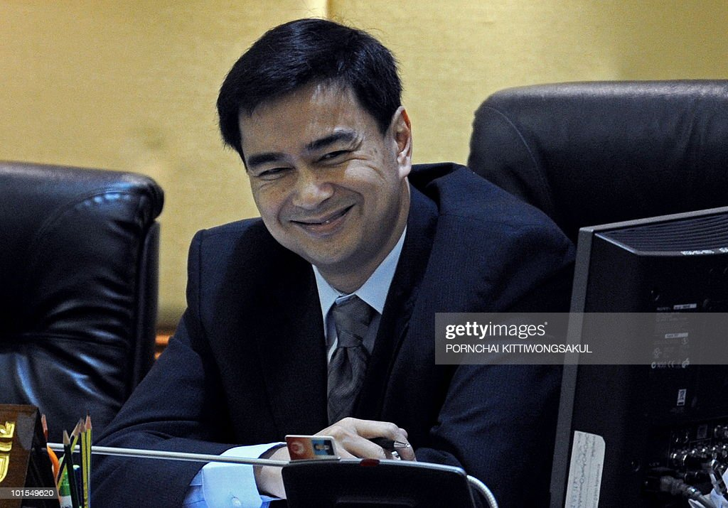 Thai Prime Minister Abhisit Vejjajiva smiles during the no-confidence vote at Parliament in Bangkok on June 2, 2010. Thailand's prime minister easily survived a parliamentary no-confidence vote over his handling of deadly protests by anti-government 'Red Shirts'.