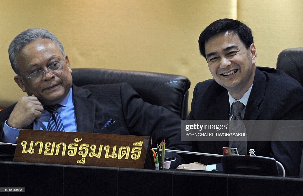 Thai Prime Minister Abhisit Vejjajiva (R) smiles next to deputy premier Suthep Thaugsuban (L) during the no-confidence vote at Parliament in Bangkok on June 2, 2010. Thailand's prime minister easily survived a parliamentary no-confidence vote over his handling of deadly protests by anti-government 'Red Shirts'.