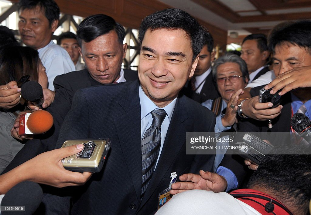 Thai Prime Minister Abhisit Vejjajiva smiles while answers the question from the press after the no-confidence vote at Parliament in Bangkok on June 2, 2010. Thailand's prime minister easily survived a parliamentary no-confidence vote over his handling of deadly protests by anti-government 'Red Shirts'.