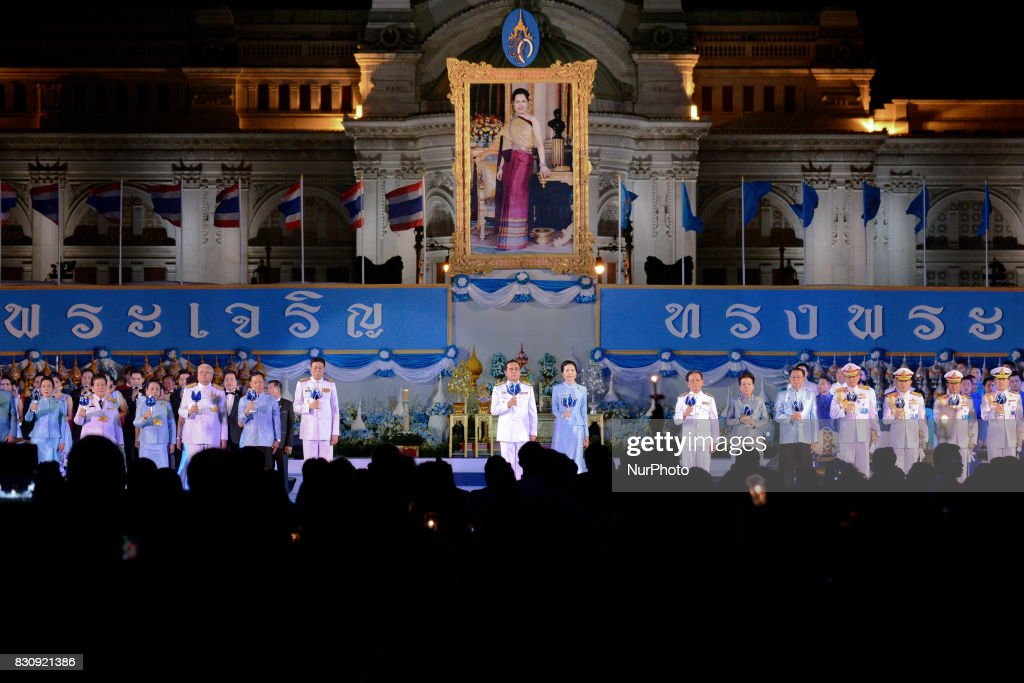 Thai Prime Minister Prayut Chan-o-cha (L) and his wife Naraporn (R) light a candle in front of a large picture of Thai Queen Sirikit, to celebrate of Queen Sirikit's birthday at Bangkok, Thailand, 12 August 2017.