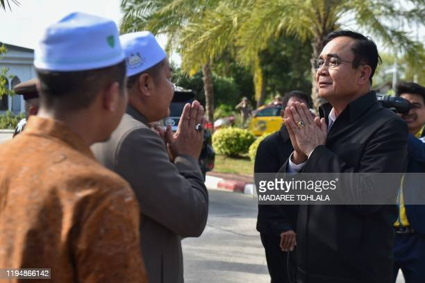 Thai Prime Minister Prayut ChanOCha greets Muslim religious officials during a visit in Thailand's southern province of Narathiwat on January 20 2020...