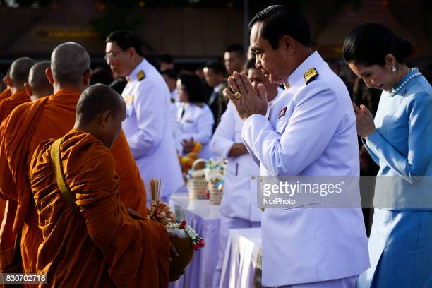 Thai Prime Minister Prayuth ChanOCha gives alms to Buddhist monks to celebrate the Queens Sirikit' 85th birthday in Bangkok Thailand 12 August 2017