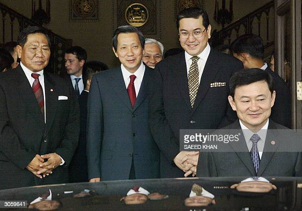Thai Prime Minister Thaksin Shinawatra along with cabinet members Foreign Minister Surakiart Sathirathai Industry Minister Pinij Jarusombat and...
