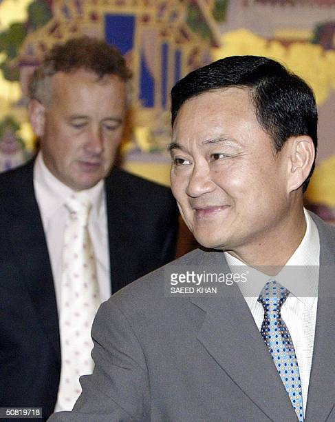 Thai Prime Minister Thaksin Shinawatra arrives to hold talks with Rick Parry chief executive of English Premier League football club Liverpool and...
