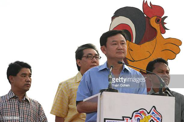 Thai Prime Minister, Thaksin Shinawatra, during an event to promote poultry at the Sanam Luang, in front of the Royal Palace in the Thai capital,...