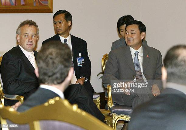 Thai Prime Minister Thaksin Shinawatra hold talks with Rick Parry chief executive of English Premier League football club Liverpool and other...