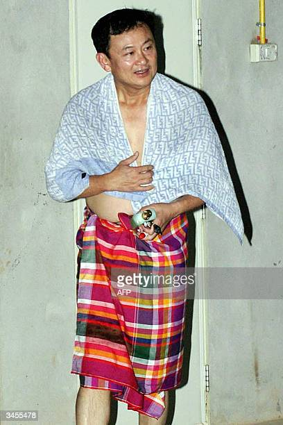 Thai Prime Minister Thaksin Shinawatra leaves a bathroom at Ban Tat Forest Temple in Udon Thani province northeast of Thailand 21 April 2004 The Thai...