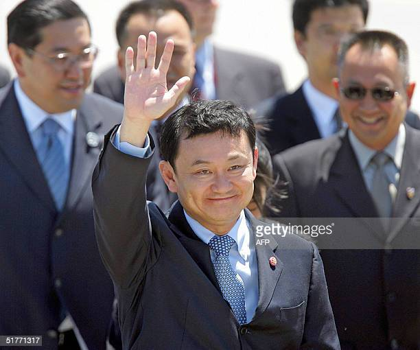 Thai Prime Minister Thaksin Shinawatra waves upon his arrival at the Santiago Airport 19 November 2004 to takes part at the APEC Summit. Leaders of...