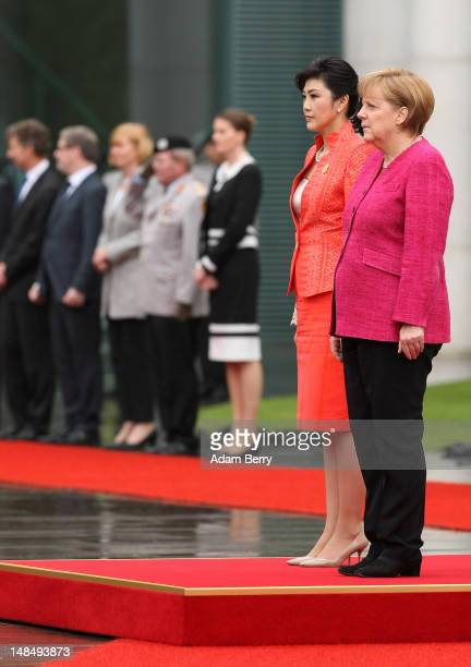 Thai Prime Minister Yingluck Shinawatra and German Chancellor Angela Merkel attend a military ceremony upon Yingluck's arrival at the German federal...