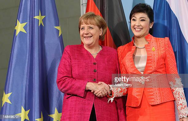 Thai Prime Minister Yingluck Shinawatra and German Chancellor Angela Merkel shake hands after a news conference at the German federal chancellory on...