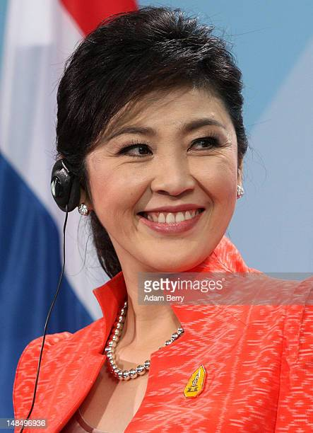 Thai Prime Minister Yingluck Shinawatra listens during a news conference at the German federal chancellory on July 18, 2012 in Berlin, Germany....