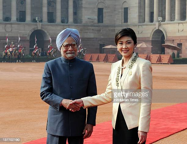 Thai Prime Minister Yingluck Shinawatra shakes hands with Prime Minister Manmohan Singh during her ceremonial reception at President House on January...