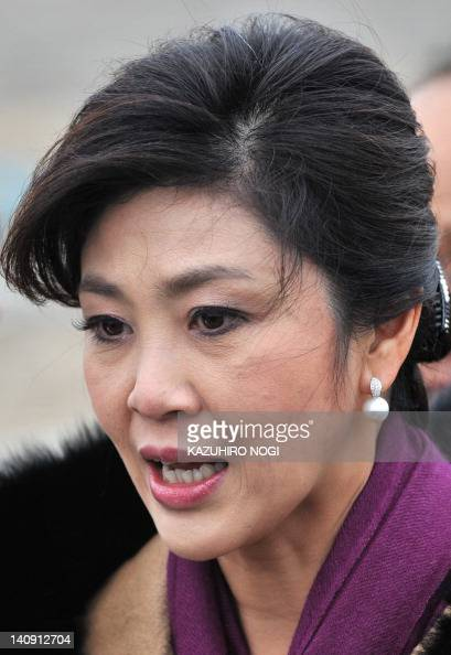 Yingluck Shinawatra poses for photos during an interview