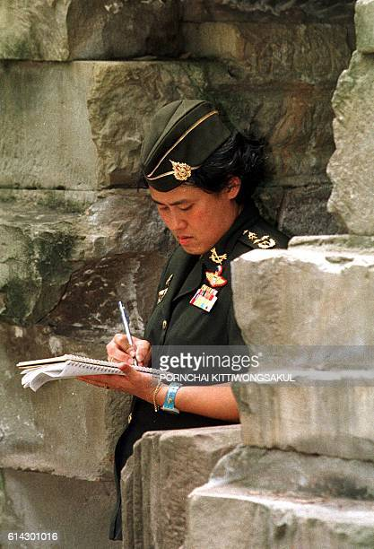 Thai Princess Maha Chakri Sirindhorn makes notes during of her visit to Banteay Chamar Hindu temple in Banteay Meanchey province, Cambodia 22 June...