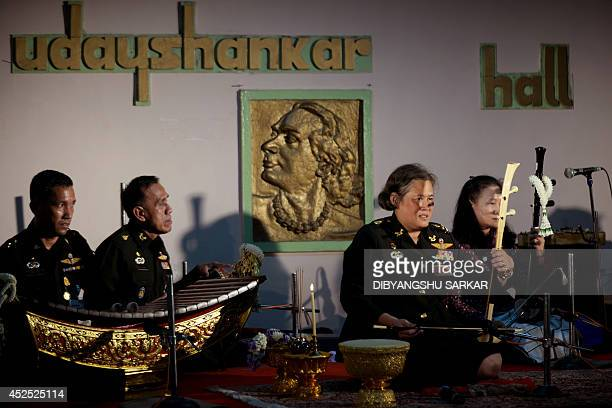 Thai Princess Maha Chakri Sirindhorn takes part in a musical performance during a visit to the birthplace of Indian nobel laureate Rabindranath...