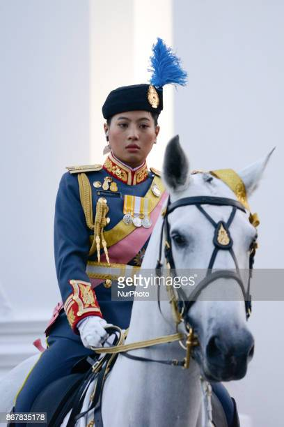 Thai Princess Sirivannavari march in a procession to escort the relics and bone ashes of Thailand late King Bhumibol Adulyadej to be enshrined in two...