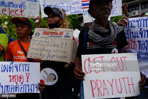 Thai pro-democracy activists and supporters display placards during a demonstration against military's in Bangkok, Thailand May 5, 2018.