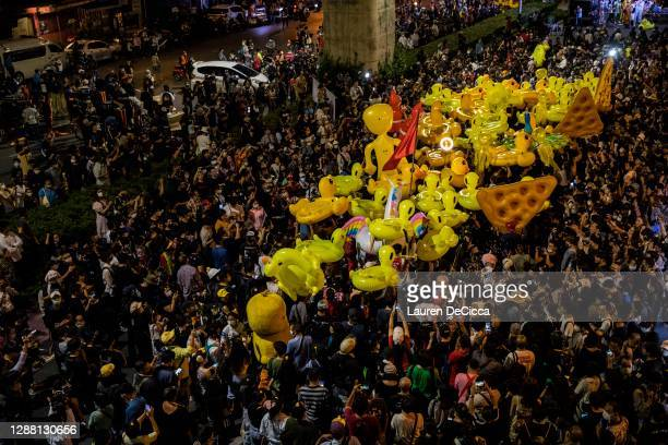 Thai pro-democracy protesters carry rubber ducks through the crowd during a rally on November 27, 2020 in Bangkok, Thailand. Protesters descended on...