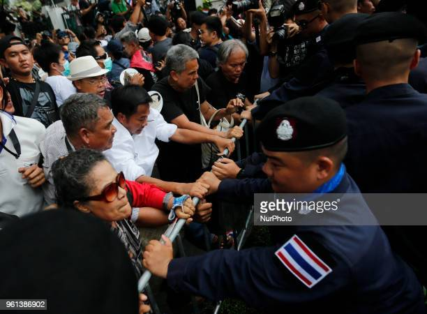 Thai prodemocracy protesters scuffle with policemen after they were blocked from marching to Government House during a rally call for general...