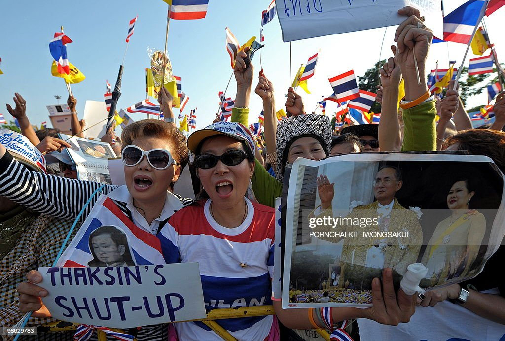 Thai pro-government supporters wave national flags and portraits of Thai King Bhumibol Adulyadej (R) during a demonstration to counter anti-government 'Red Shirt' protests at Royal plazza in Bangkok on April 23, 2010. Thai police sought to push back anti-government 'Red Shirts' from a confrontation zone in Bangkok after deadly grenade attacks stoked tensions in the long-running political standoff.