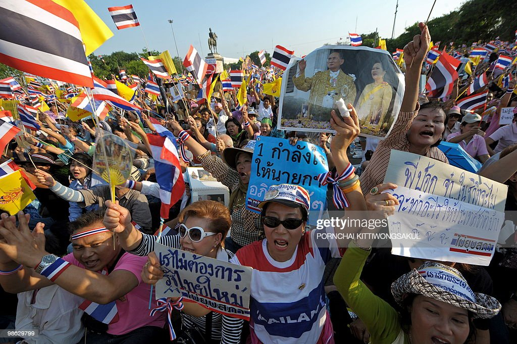 Thai pro-government supporters wave national flags and portraits of Thai King Bhumibol Adulyadej during a demonstration to counter anti-government 'Red Shirt' protests at Royal plazza in Bangkok on April 23, 2010. Thai police sought to push back anti-government 'Red Shirts' from a confrontation zone in Bangkok after deadly grenade attacks stoked tensions in the long-running political standoff.