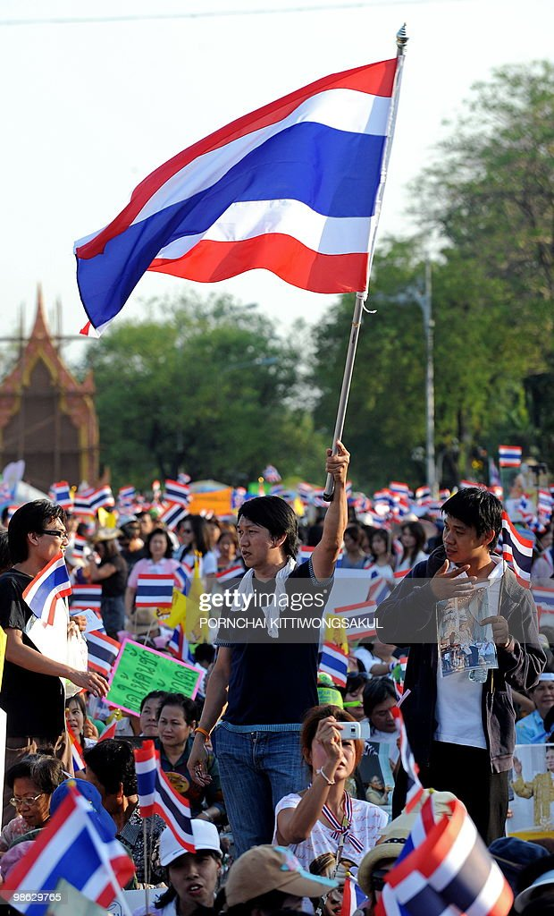 Thai pro-government supporters wave national flags during a demonstration to counter anti-government 'Red Shirt' protests at Royal plazza in Bangkok on April 23, 2010. Thai police sought to push back anti-government 'Red Shirts' from a confrontation zone in Bangkok after deadly grenade attacks stoked tensions in the long-running political standoff.