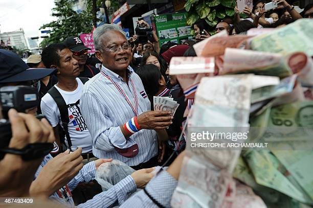 Thai protest leader Suthep Thaugsuban collects donations from supporters during an antigovernment march in downtown Bangkok on February 7 2014 Thai...