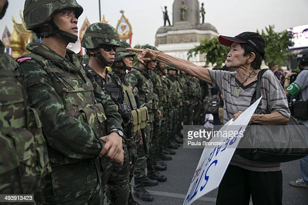 Thai protester points a finger at the Thai military during an anti-coup protests as General Prayuth receives the Royal Endorsement as the military...