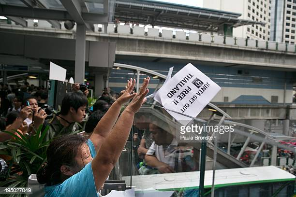 Thai protesters attempt a demonstration before the military police shut them down outside a shopping mall on June 1 2014 in Bangkok Thailand Thai...