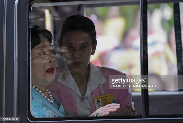 Thai Queen Sirikit sits in her car as she leaves along with King Bhumibol Adulyadej in a motorcade from Siriraj hospital in Bangkok on September 15,...