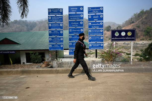 Thai ranger walks through Mae Sam Laep town on the Thai side of the Salween river in Mae Hong Son province on April 2 across from where Myanmar...