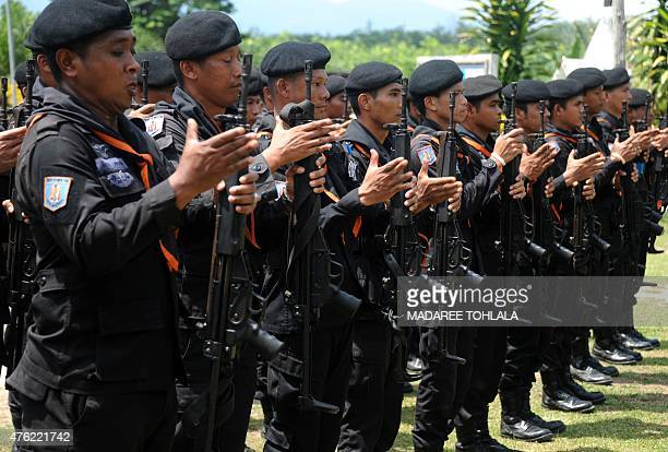 Thai rangers stand at attention as they train ahead of the start of Ramadan in midJune in the Chanae district of Thailand's restive southern province...