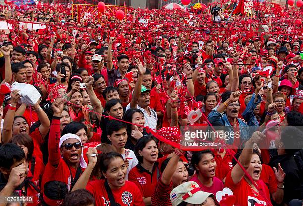 Thai red shirt protesters cheer during a large peaceful red shirt rally on December 19 2010 in BangkokThailand Today's rally marked the seven month...