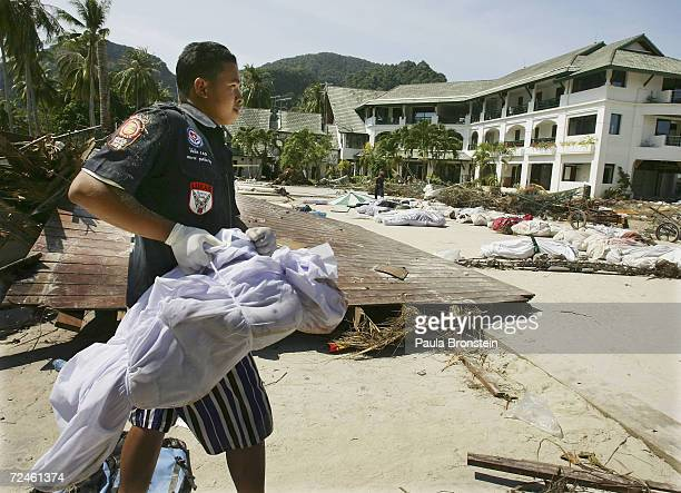 Thai rescue worker carries the body of a baby on December 28 2004 in Ton Sai Bay on Phi Phi island Thailand Hundreds were killed when the island was...