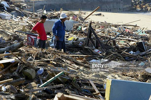 Thai rescuers search for more victims through the debris washed away from resorts on the shoreline of Khao Lak beach 30 December 2004 The final death...
